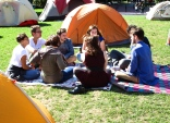 DivestNU members meditate among the tents on Centennial Quad.