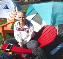 "Zuzu Oomen-Lochtefeld does some studying on an adirondack chair in DivestNU's campsite. ""Something like this can show so many of us care about this--it's like the Occupy Movement,"" she said."