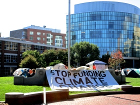 Students hung a large banner on top of the Centennial Quad marker. The event adopted the hashtag: #FossilFreeCentennial.